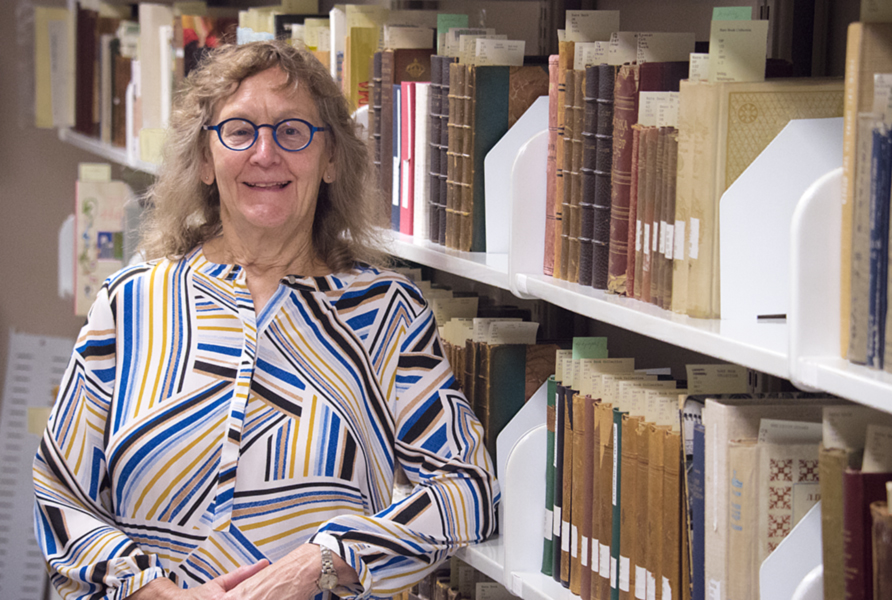 A portrait of Tamara Belts in the stacks at Special Collections