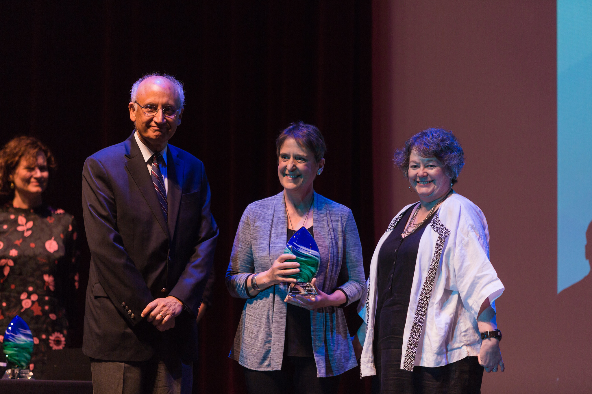 the Counseling Center's Anne Marie Theiler accepts an award at last year's Employee Recognition Ceremony. All three staff and faculty awards events have been combined into one event for the first time, the Celebration of Excellence.