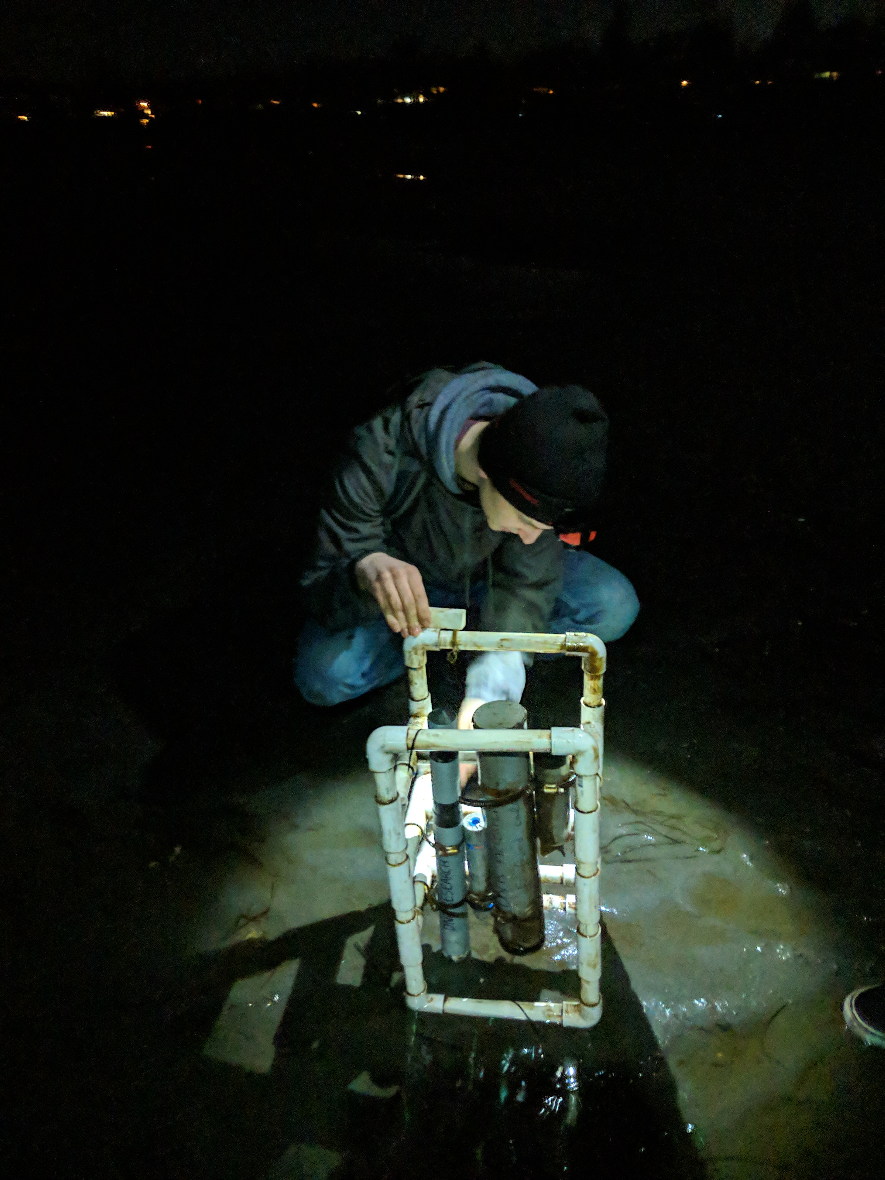 WWU student Dexter Davis cleans an ocean acidification sensor for his volunteer citizen-science work with North Sound Stewards in Bellingham .