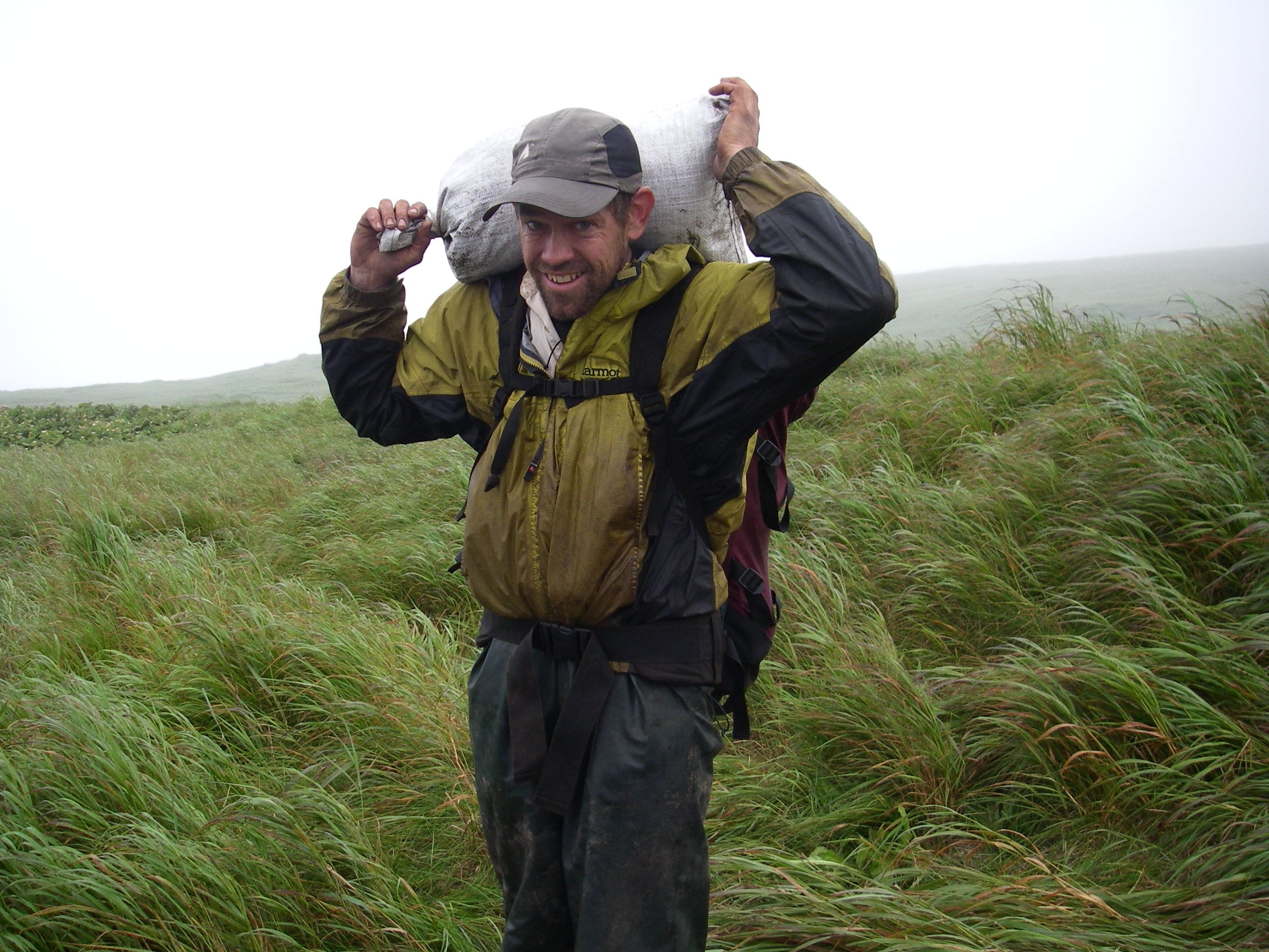 Etnier excavating a midden in the North Pacific's Kuril Islands.