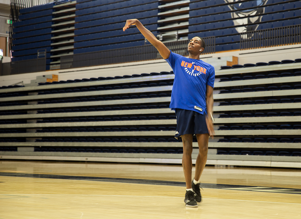 New Western Washington University basketball player Bryce Knox shooting hoops in Carver Gym