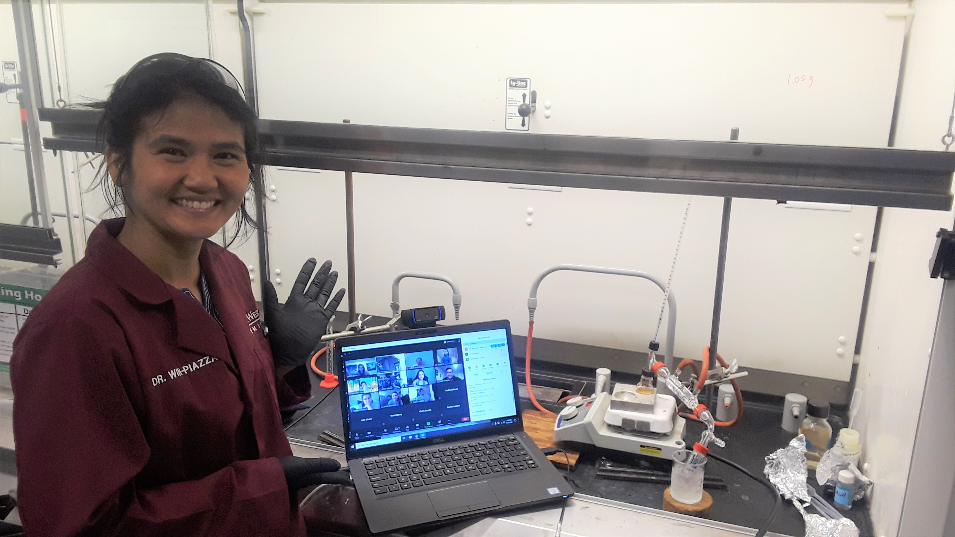 Hla Win-Piazza, the CHEM 354 lab coordinator, works with her class in the lab via Zoom.