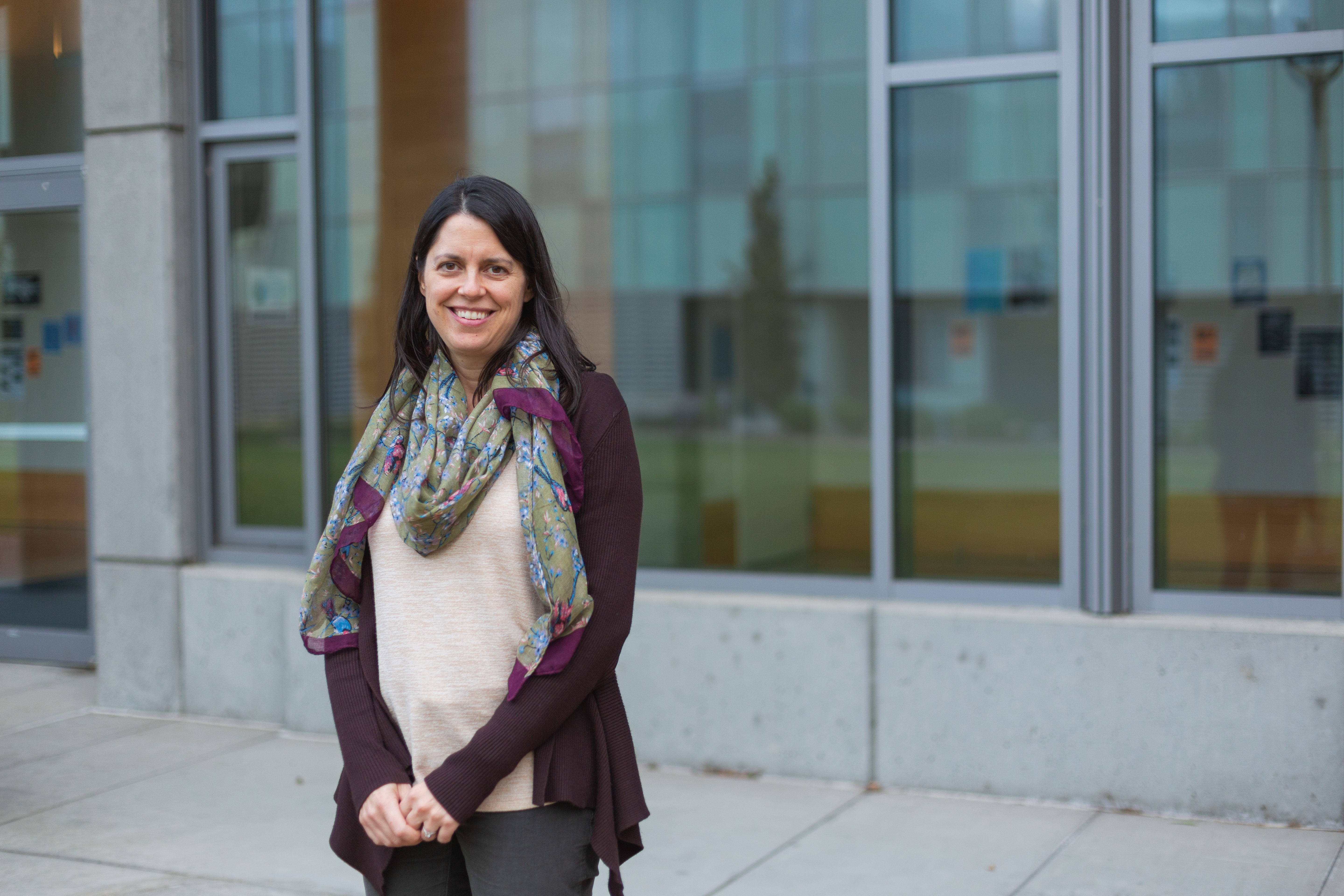 Emily Borda poses in front of the SMATE building