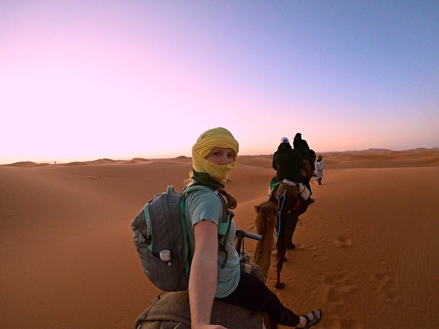 WWU student Nicole Crook on the back of a camel in Morocco on her Gilman scholarship