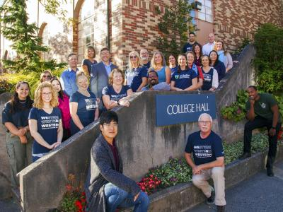 OCE staff poses in front of College Hall
