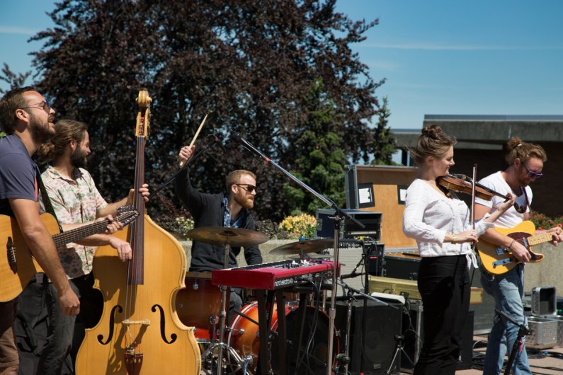 Polecat plays on the Performing Arts Center Plaza in the first show of the 2016 Summer Noon Concert Series on June 29, 2016. Photo by Jonathan Williams / WWU