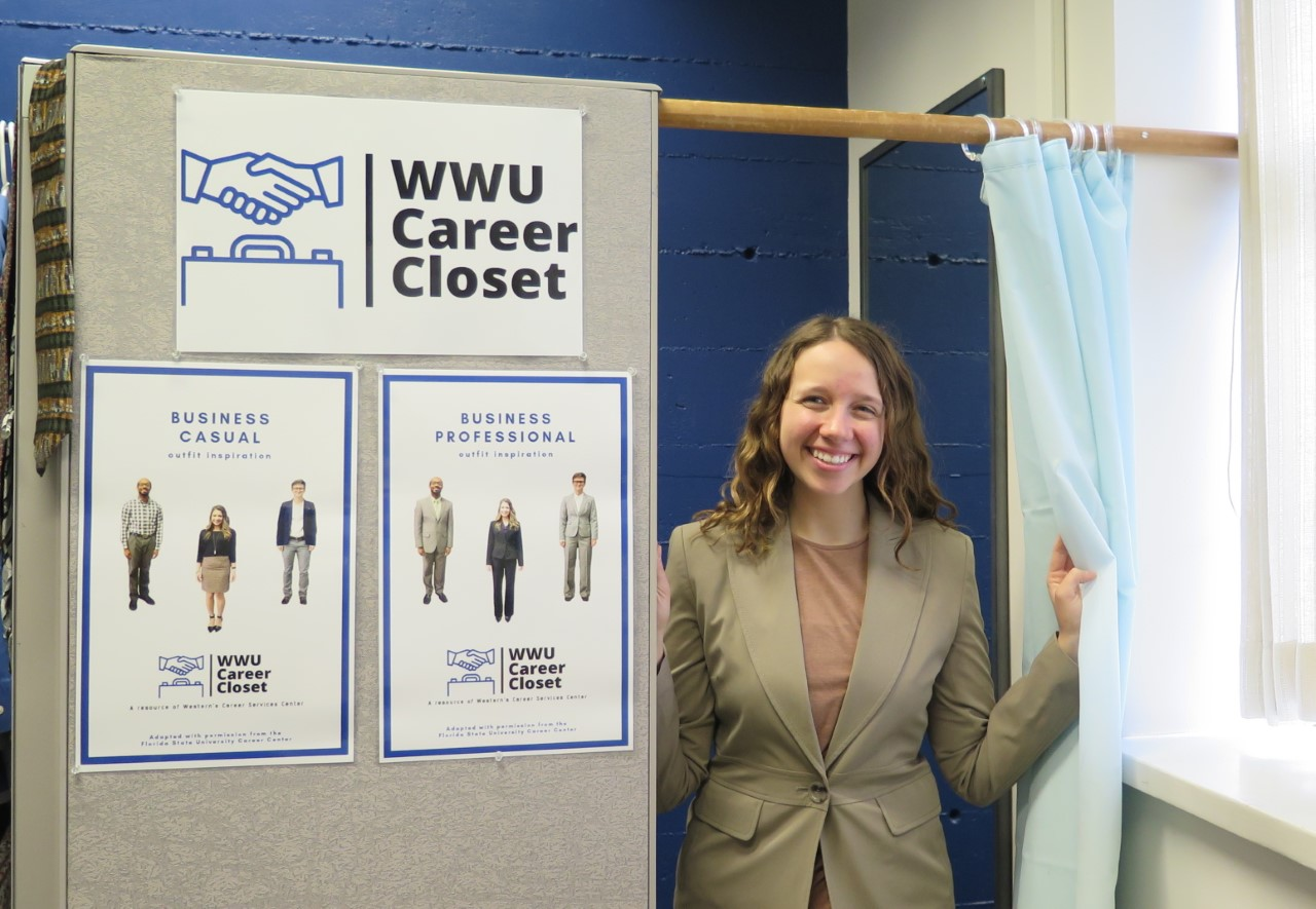 Madison Crinklaw, student peer advisor in the Career Services Center, checks out the Career Closet.